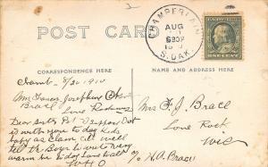 Chamberlain South Dakota PM~Hick the Artist~Man Leans on Front Porch~1910 RPPC