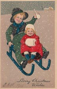 CHRISTMAS; 1906; Children in snowfall sledding, hand muff, baby bottle, PFB 6211