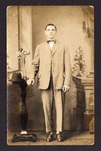 1904-1918 RPPC J H SINCASTER 651 BANK ST WATERBURY CONNECTICUT CT MAN IN BOW TIE