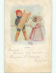 Pre-Linen CUTE GIRL WITH MUFF HAND WARMER BESIDE BOY WITH SLED J3204