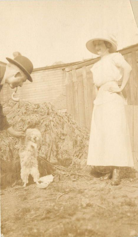 Real Photo Postcard; Woman, Man w Pipe & Lap Dog Maltese? Posted 1912