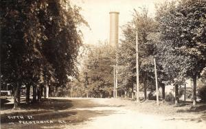 Pecatonic IL~Dirt Fifth Street~Standpipe Dwarfs Trees. Telephone Poles~RPPC