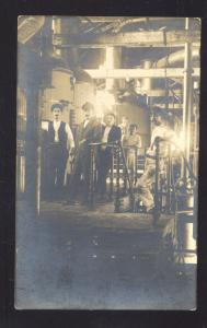 RPPC FACTORY INTERIOR GROUP OF MEN WORKERS VINTAGE REAL PHOTO POSTCARD