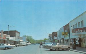 Frederick Wisconsin~Street Scene~Coast-to-Coast~Man Wearing Bell-Bottoms~1960s