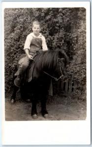 RPPC  Young BOY RIDING BLACK PONY ca 1920s-40s  Real Photo  Postcard