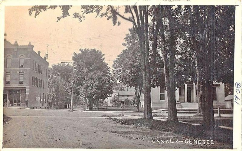 Genesee NY Dirt Street Canal Bicycle in 1909 RPPC Postcard