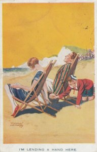 AS; 'I'm lending a hand here Trouble maker holding man's hand at beach, PU-1928