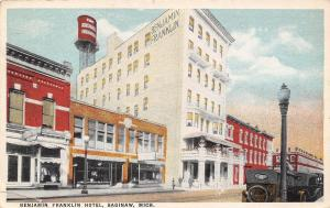 Saginaw Michigan~Benjamin Franklin Hotel~Water Tower~Storefronts~1924 Postcard
