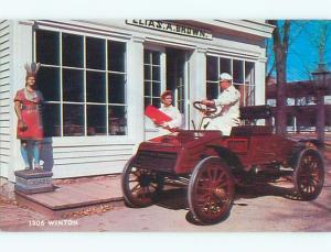 Unused 1970's postcard ANTIQUE CIGAR STORE INDIAN BESIDE 1906 WINTON CAR k9064