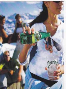 Snowboarder drops out of a bottle of PERRIER Water , 1990s