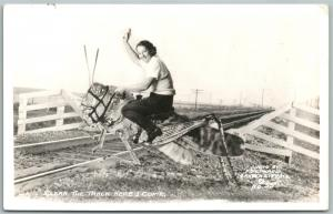 EXAGGERATED GRASSHOPPER on RAILROAD TRACKS 1938 VINTAGE REAL PHOTO POSTCARD RPPC