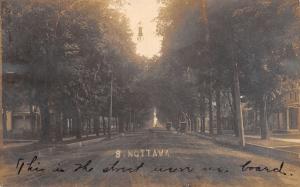 Sturgis MI Two Buggies on S Nottawa Where We Board~Home w/Long Windows RPPC 1905