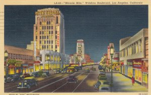 LOS ANGELES , California, 1930-40s; Wilshire Boulevard at night, store fronts