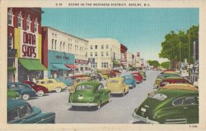 SHELBY NC - view of business district filled with old cars - 1940s