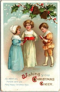 Vintage 1911 CHRISTMAS Greetings Postcard Un-Signed Clapsaddle Art /Kids Singing