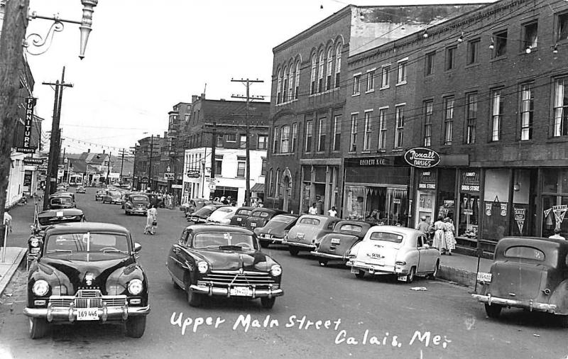 Calais ME Upper Main Street Storefronts Gas Stations Old Cars RPPC