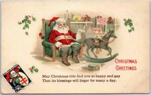 Christmas Postcard SANTA CLAUS in Easy Chair, Reading List w/ 1920 XMAS SEAL
