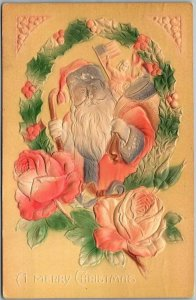 1911 Embossed MERRY CHRISTMAS Postcard Airbrushed SANTA CLAUS / Holly Wreath