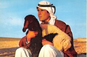 Israel A Shepherd boy with one of his flock  A Shepherd boy with one of his f...