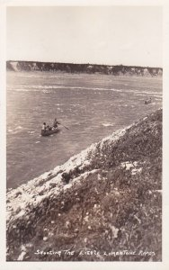 RP: MANITOBA ,Canada ,1910-20s; Men in canoes shooting the Little Limestone R...