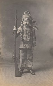 RP: Child in indian costume holding a musket , 00-10s