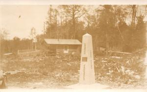 Cement Canada/US Border Boundary Marker-Log Cabin RPPC c1927