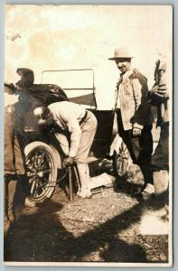 Real Photo Postcard~Men Pumping Up Tire on Vintage Auto~One Works~3 Watch~c1908