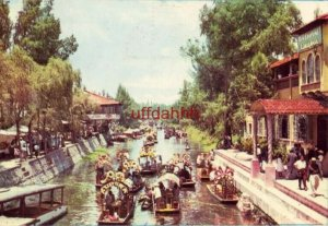 XOCHIMILCO MEXICO WERE (sp) GAYETY, MUSIC AND FLOWER DECORATED CANOES WAIT 1960