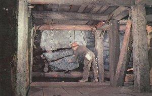 SUDBURY , Ontario , Canada , 1950-60s ; Loading holes for blasting , Mining