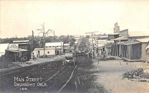 Drumright OK Dirt Street View Store Fronts Horse & Wagons RPPC Postcard