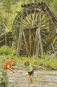 Couple at Perry Creek Water Wheel, Ft. Steele Historic Park, Kootenay Rocky M...