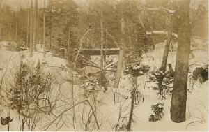 Huntington VT~Bridge & Trees Near Lumbermen? Syrup Gathering? Camp~RPPC c1913