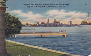 Highway And Railroad Bridges Across Saint Johns River Skyline In Background J...
