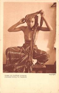 Indonesia, Republik Indonesia Javanese binding his headcloth  Javanese bindin...
