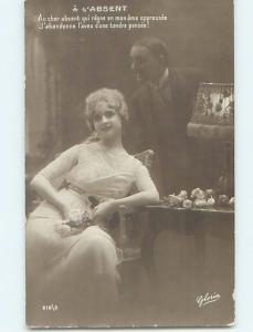 c1910 rppc ANTIQUE LAMP ON TABLE BESIDE PRETTY WOMAN HM1094