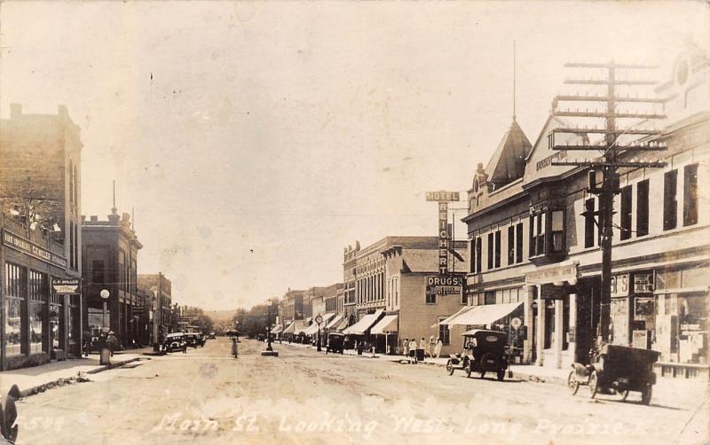 Long Prairie MN~Peoples National Bank~Reichert Hotel~Miller Implement RPPC 1928