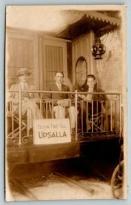 Detta Tag Till Upsalla/Uppsala~3 Gents in Fancy Caboose~RPPC Studio Prop~c1924