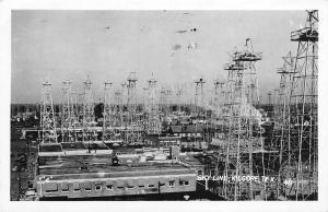 Kilgore Texas~Downtown Oil Well Skyline~Texaco~Leslie Drug~Kaplan's~1953 RPPC