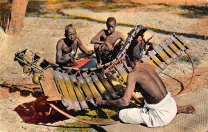 Africa Men playing Balafon Tinted Real Photo Antique Postcard J67794