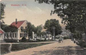 25310 NH, Wentworth, street with horse and buggy passnig by houses