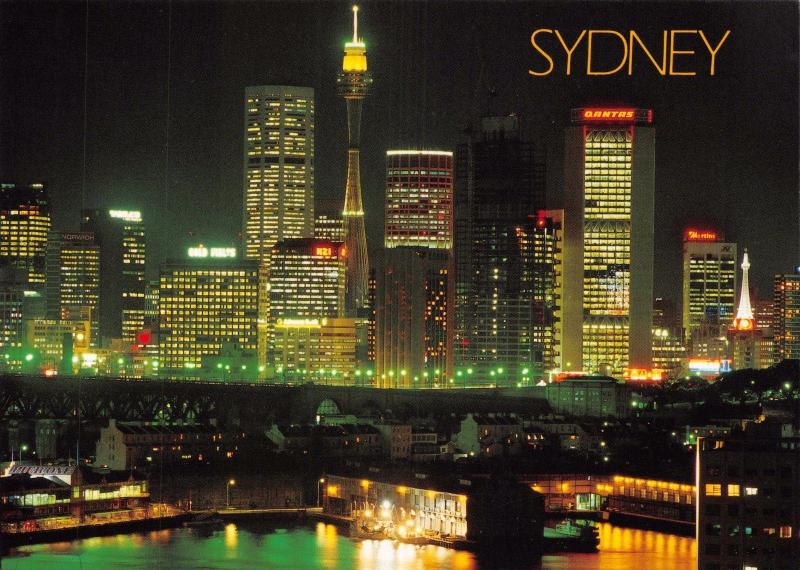 Postcard SYDNEY Skyline at Night with Pier One and the Historic Rocks #S