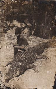Black American Young Boy Sitting On Crocile Real Photo