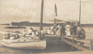 G98/ Interesting RPPC Postcard c1910 Patriotic Flag Boat Dock Sail Boat 2