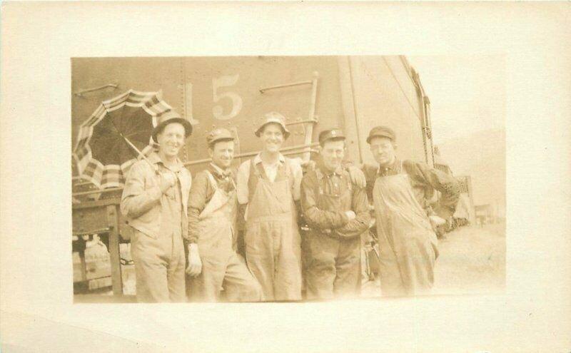 C-1910 Railroad Occupation workers Umbrella RPPC Photo Postcard 6020