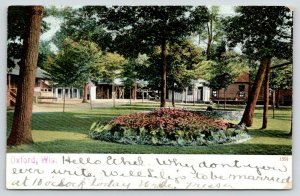Oxford Wisconsin~Ice Cream Shop~Flower Bed Near Park Bandstand 1907 Postcard