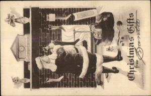 Christmas - Santa Claus Fills Stockings b&w c1910 Postcard rpx