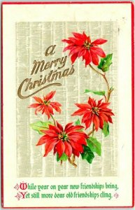Vintage A MERRY CHRISTMAS Embossed Postcard Poinsettia Flowers c1910s