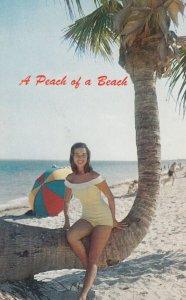 Pin-up girl at beach ; A Peach of a Beach , 1950-60s