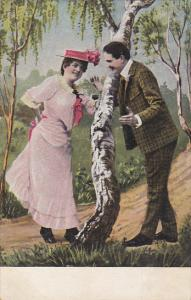 Romantic Couple Talking Around Tree