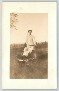 La Moille Illinois~Mother in Field w/ Baby Carriage~LM Post Card Works~1910 RPPC